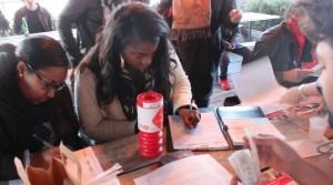 Girls Filling in Registration Forms